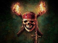 кино - пираты карибского моря - факел, череп
